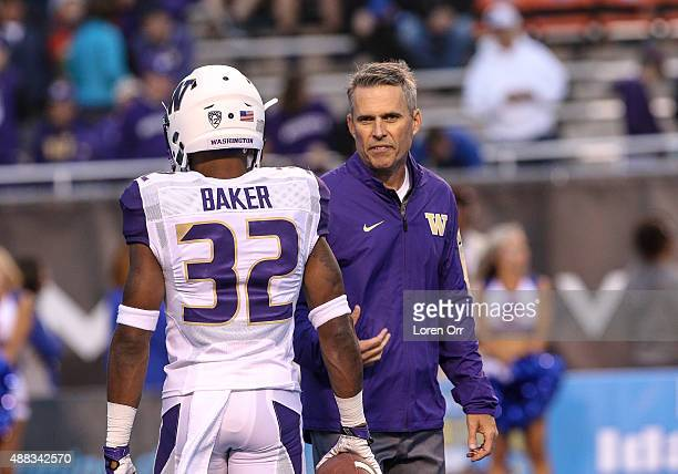 Head coach Chris Peterson of the Washington Huskies and defensive back Budda Baker during pregame warmup on September 4 2015 at Albertsons Stadium in...