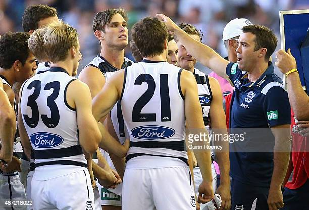 head coach Chris Scott of the Cats talks to his players during the NAB Challenge AFL match between the Carlton Blues and the Geelong Cats at Etihad...