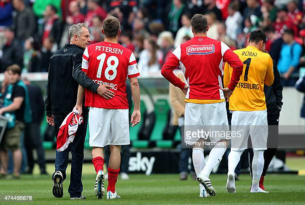 Head coach Christian Streich Nils Petersen goalkeeper Sebastian Mielitz and goalkeeper Roman Buerki of Freiburg leave the pitch after the Bundesliga...