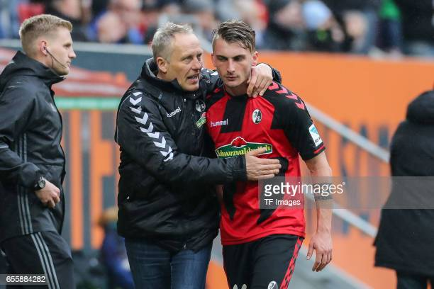 Head coach Christian Streich of Freiburg and Maximilian Philipp of Freiburg looks on during the Bundesliga match between FC Augsburg and SC Freiburg...