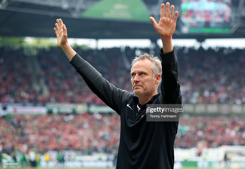 Head coach <a gi-track='captionPersonalityLinkClicked' href=/galleries/search?phrase=Christian+Streich&family=editorial&specificpeople=4411796 ng-click='$event.stopPropagation()'>Christian Streich</a> of Freiburg applauds the fans after the Bundesliga match between Hannover 96 and SC Freiburg at HDI-Arena on May 23, 2015 in Hanover, Germany.