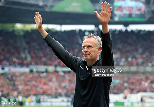 Head coach Christian Streich of Freiburg applauds the fans after the Bundesliga match between Hannover 96 and SC Freiburg at HDIArena on May 23 2015...