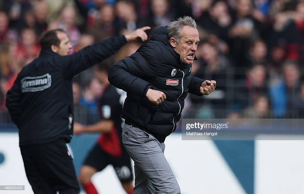 Head coach <a gi-track='captionPersonalityLinkClicked' href=/galleries/search?phrase=Christian+Streich&family=editorial&specificpeople=4411796 ng-click='$event.stopPropagation()'>Christian Streich</a> of Freiburg celebrates after the fourth goal for his team during the Second Bundesliga match between SC Freiburg and SpVgg Greuther Fuerth at Schwarzwald-Stadion on October 18, 2015 in Freiburg im Breisgau, Germany.
