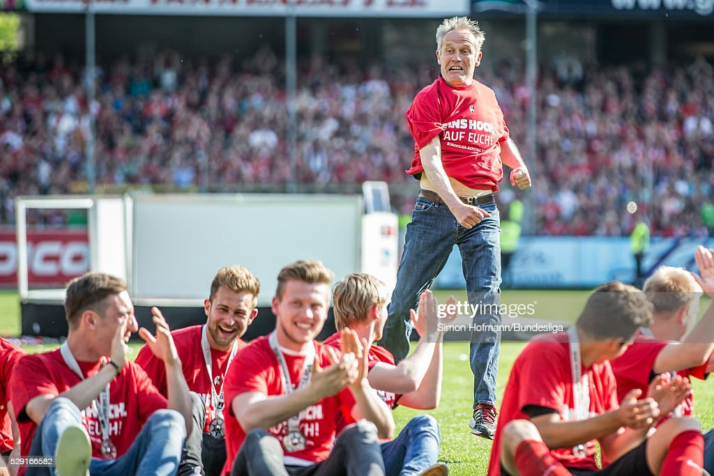 Head coach <a gi-track='captionPersonalityLinkClicked' href=/galleries/search?phrase=Christian+Streich&family=editorial&specificpeople=4411796 ng-click='$event.stopPropagation()'>Christian Streich</a> of Freiburg celebrates after the Second Bundesliga match between SC Freiburg and 1. FC Heidenheim at Schwarzwald-Stadion on May 08, 2016 in Freiburg im Breisgau, Baden-Wuerttemberg.