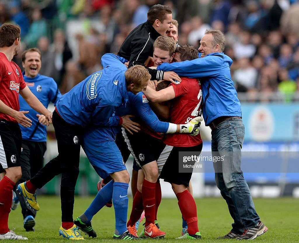 head coach <a gi-track='captionPersonalityLinkClicked' href=/galleries/search?phrase=Christian+Streich&family=editorial&specificpeople=4411796 ng-click='$event.stopPropagation()'>Christian Streich</a> of Freiburg celebrates the win with his players after the Bundesliga match between SpVgg Greuther Fuerth and SC Freiburg at Trolli-Arena on May 11, 2013 in Fuerth, Germany.