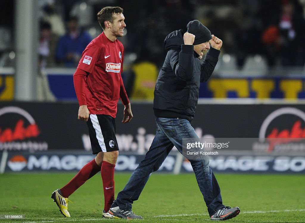 Head coach <a gi-track='captionPersonalityLinkClicked' href=/galleries/search?phrase=Christian+Streich&family=editorial&specificpeople=4411796 ng-click='$event.stopPropagation()'>Christian Streich</a> (R) of Freiburg celebrates with Julian Schuster after the Bundesliga match between SC Freiburg and Fortuna Duesseldorf 1895 at MAGE SOLAR Stadium on February 10, 2013 in Freiburg im Breisgau, Germany.