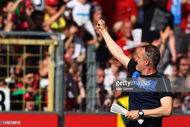 Head coach Christian Streich of Freiburg celebrates with the fans after the Bundesliga match between SC Freiburg and 1 FC Koeln at Badenova Stadium...