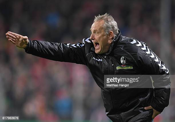 Head coach Christian Streich of Freiburg gestures during the DFB Cup match between SC Freiburg and SV Sandhausen at SchwarzwaldStadion on October 25...