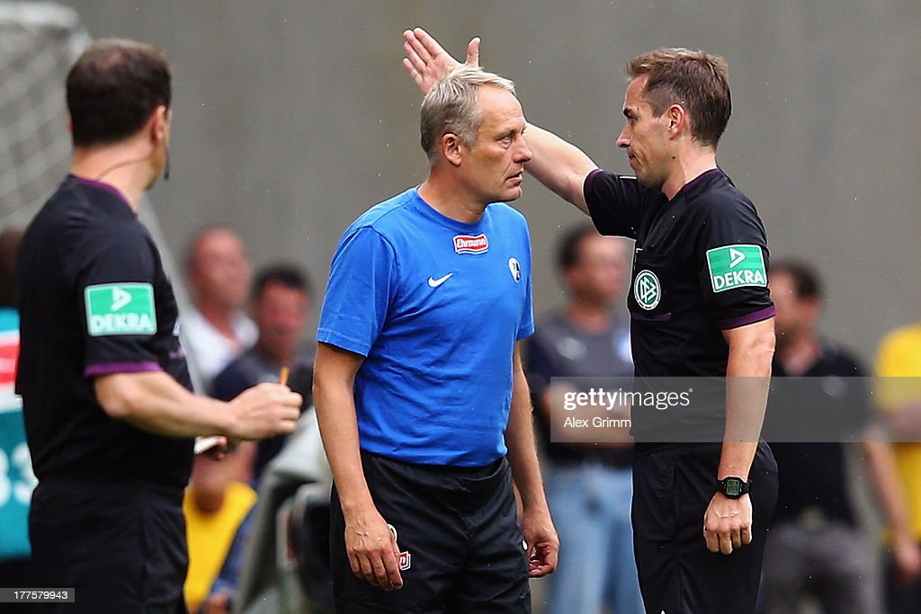 Head coach <a gi-track='captionPersonalityLinkClicked' href=/galleries/search?phrase=Christian+Streich&family=editorial&specificpeople=4411796 ng-click='$event.stopPropagation()'>Christian Streich</a> of Freiburg is sent off by referee Tobias Stieler during the Bundesliga match between 1899 Hoffenheim and SC Freiburg at Wirsol Rhein-Neckar-Arena on August 24, 2013 in Sinsheim, Germany.