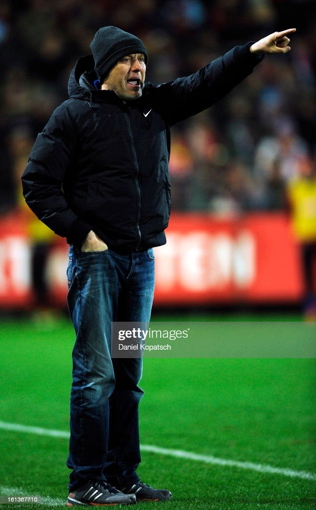 Head coach <a gi-track='captionPersonalityLinkClicked' href=/galleries/search?phrase=Christian+Streich&family=editorial&specificpeople=4411796 ng-click='$event.stopPropagation()'>Christian Streich</a> of Freiburg reacts during the Bundesliga match between SC Freiburg and Fortuna Duesseldorf 1895 at MAGE SOLAR Stadium on February 10, 2013 in Freiburg im Breisgau, Germany.