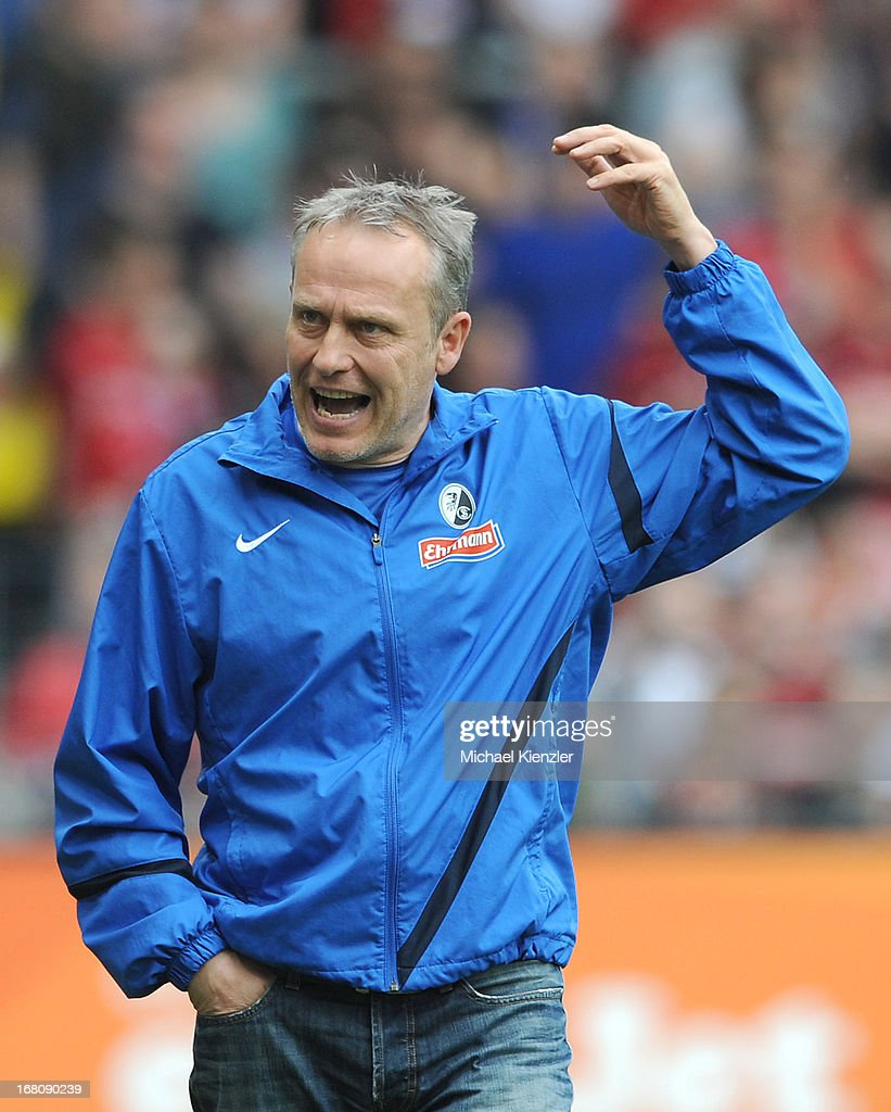 Head coach <a gi-track='captionPersonalityLinkClicked' href=/galleries/search?phrase=Christian+Streich&family=editorial&specificpeople=4411796 ng-click='$event.stopPropagation()'>Christian Streich</a> of Freiburg reacts during the Bundesliga match between SC Freiburg and FC Augsburg at MAGE SOLAR Stadium on May 5, 2013 in Freiburg, Germany.