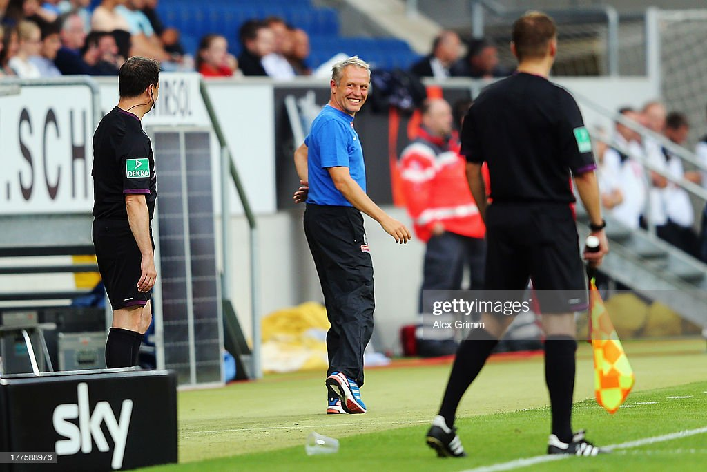 Head coach <a gi-track='captionPersonalityLinkClicked' href=/galleries/search?phrase=Christian+Streich&family=editorial&specificpeople=4411796 ng-click='$event.stopPropagation()'>Christian Streich</a> of Freiburg smiles during the Bundesliga match between 1899 Hoffenheim and SC Freiburg at Wirsol Rhein-Neckar-Arena on August 24, 2013 in Sinsheim, Germany.