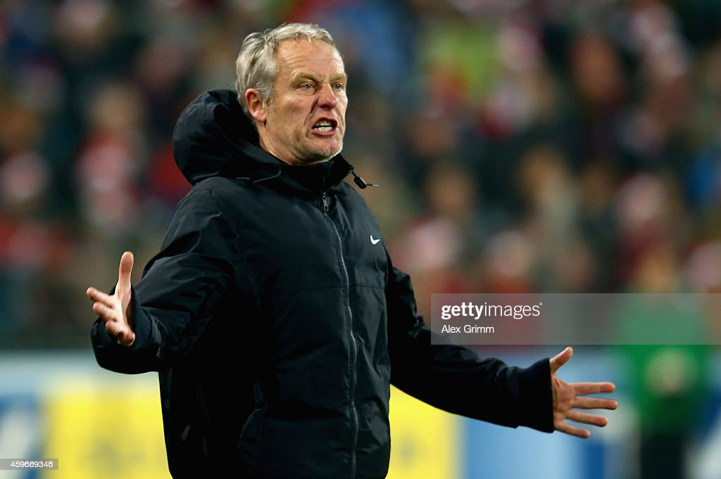 Head coach <a gi-track='captionPersonalityLinkClicked' href=/galleries/search?phrase=Christian+Streich&family=editorial&specificpeople=4411796 ng-click='$event.stopPropagation()'>Christian Streich</a> of SC Freiburg reacts during the Bundesliga match between Sport-Club Freiburg and VfB Stuttgart at Schwarzwald-Stadion on November 28, 2014 in Freiburg im Breisgau, Germany.