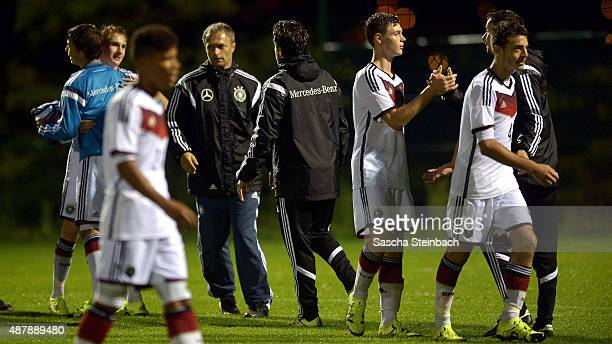 Head coach Christian Wueck and players of Germany celebrate after winning the U16 international friendly match against Belgium on September 12 2015...
