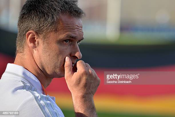 Head coach Christian Wueck of Germany looks on prior to the UEFA Under17 European Championship 2014 group B match between Germany and Scotland at...
