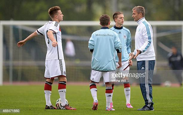 Head coach Christian Wueck of Germany speaks with his players during the half of the KOMM MIT tournament match between U17 Germany and U17 Italy on...