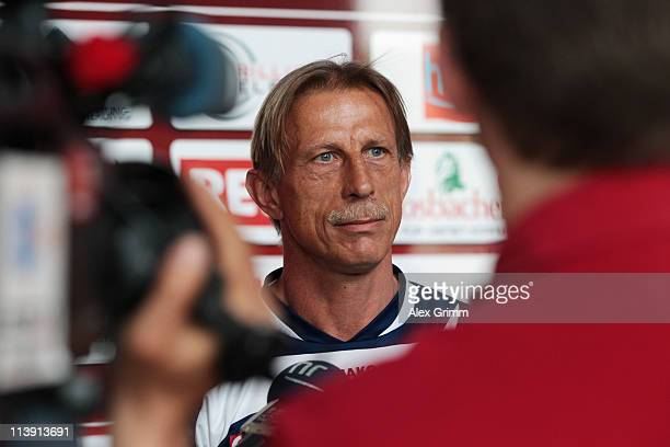 Head coach Christoph Daum is surrounded by journalists after a training session of Eintracht Frankfurt at Commerzbank Arena on May 10 2011 in...
