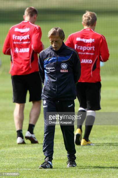 Head coach Christoph Daum of Frankfurt ponders during the training session on the training ground at the Commerzbank Arena on May 3 2011 in Frankfurt...