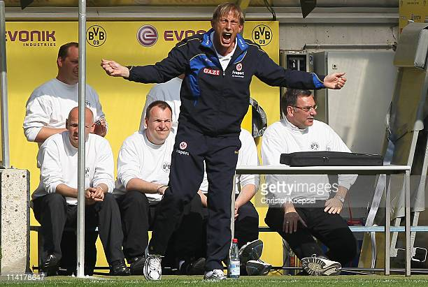 Head coach Christoph Daum of Frankfurt shows his frustration during the Bundesliga match between Borussia Dortmund and Eintracht Frankfurt at the...