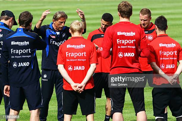 Head coach Christoph Daum talks to players during a training session of Eintracht Frankfurt at Commerzbank Arena on May 10 2011 in Frankfurt am Main...