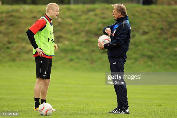 Head coach Christoph Daum talks to Sebastian Rode during a training session of Eintracht Frankfurt at Commerzbank Arena on April 5 2011 in Frankfurt...