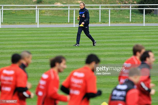 Head coach Christoph Daum walks over the pitch during a training session of Eintracht Frankfurt at Commerzbank Arena on April 5 2011 in Frankfurt am...
