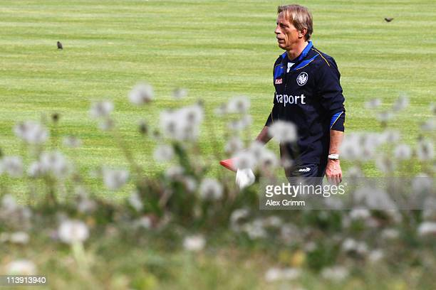 Head coach Christoph Daum walks over the pitch during a training session of Eintracht Frankfurt at Commerzbank Arena on May 10 2011 in Frankfurt am...
