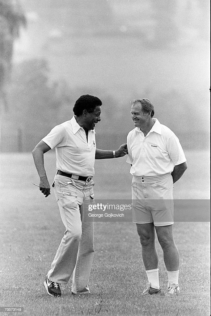Head coach Chuck Noll, right, of the Pittsburgh Steelers talks with Bill Nunn, a member of the team's player scouting staff, at summer training camp at St. Vincent College circa 1980 in Latrobe, Pennsylvania.