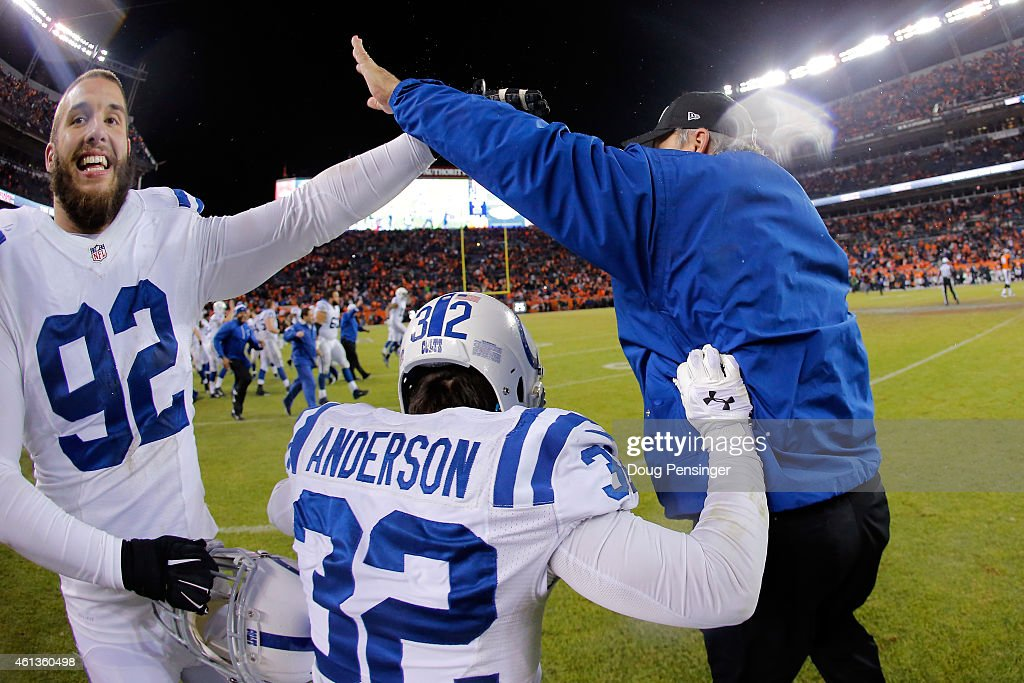 Head coach Chuck Pagano celebrates with Bjoern Werner #92 and Colt Anderson #32 of the Indianapolis Colts after defeating the Denver Broncos 24-13 in a 2015 AFC Divisional Playoff game at Sports Authority Field at Mile High on January 11, 2015 in Denver, Colorado.