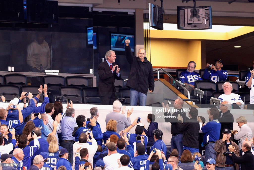 Head coach Chuck Pagano of the Indianapolis Colts acknowledges the crowd along with owner Jim Irsay during the game against the Buffalo Bills at Lucas Oil Stadium on November 25, 2012 in Indianapolis, Indiana. The Colts won 20-13.