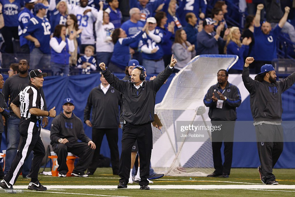 Head coach Chuck Pagano of the Indianapolis Colts celebrates after a 101-yard kickoff return for touchdown by Deji Karim against the Houston Texans during the game at Lucas Oil Stadium on December 30, 2012 in Indianapolis, Indiana. The Colts defeated the Texans 28-16.