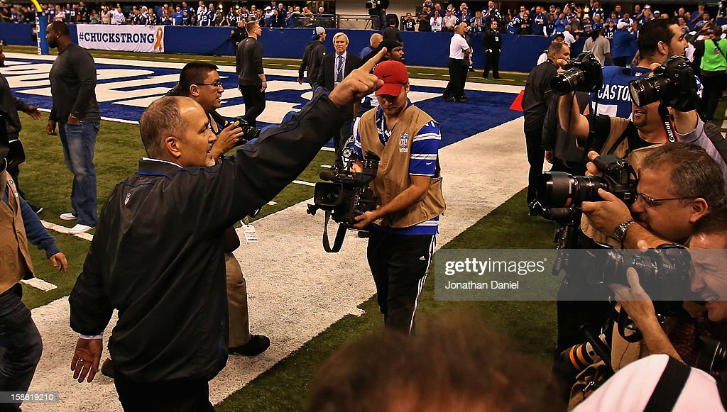 Head coach <a gi-track='captionPersonalityLinkClicked' href=/galleries/search?phrase=Chuck+Pagano&family=editorial&specificpeople=748923 ng-click='$event.stopPropagation()'>Chuck Pagano</a> of the Indianapolis Colts waves to the crowd following his return to the sidelines after treatment for leukemia and a win against the Houston Texans at Lucas Oil Stadium on December 30, 2012 in Indianapolis, Indiana. The Colts defeated the Texans 28-16.