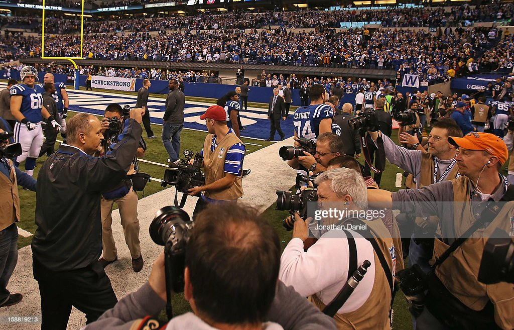 Head coach Chuck Pagano of the Indianapolis Colts waves to the crowd following his return to the sidelines after treatment for leukemia and a win against the Houston Texans at Lucas Oil Stadium on December 30, 2012 in Indianapolis, Indiana. The Colts defeated the Texans 28-16.