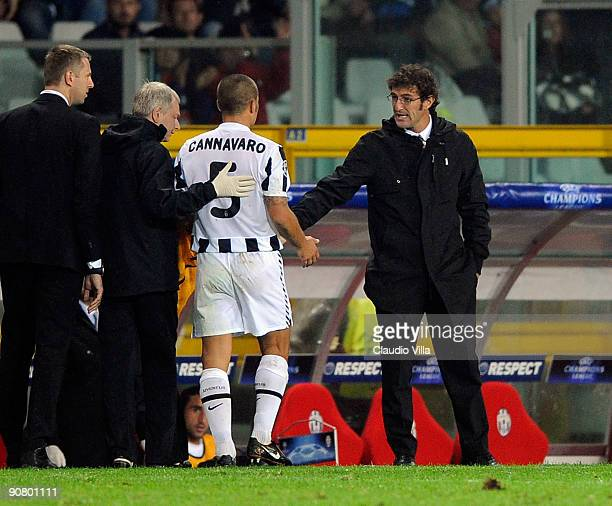 Head coach Ciro Ferrara of Juventus acknowledges Fabio Cannavaro as he leaves the pitch during the UEFA Champions League Group A match between...