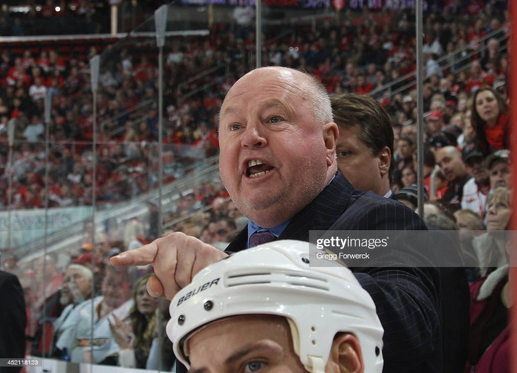 Head coach Claude Julian of the Anaheim Ducks reacts to a call made on the ice during their NHL game against the Carolina Hurricanes at PNC Arena on November 15, 2013 in Raleigh, North Carolina.
