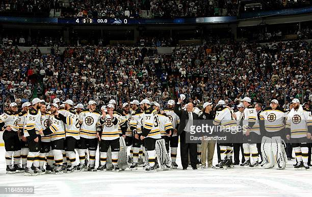 Head coach Claude Julien and the Boston Bruins celebrate winning the Stanley Cup after they defeated the Vancouver Canucks 40 in Game Seven of the...