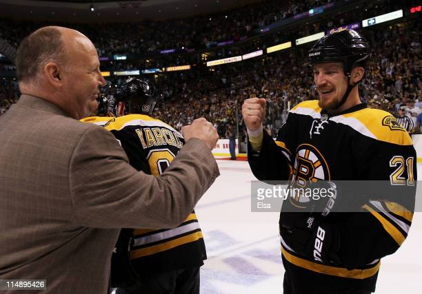 Head coach Claude Julien celebrates with Andrew Ference of the Boston Bruins after they defeated the Tampa Bay Lightning 1 to 0 in Game Seven of the...