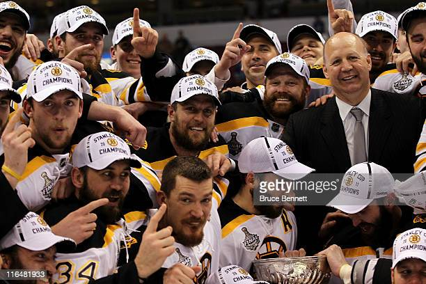 Head coach Claude Julien Dennis Seidenberg Tim Thomas Patrice Bergeron and Zdeno Chara of the Boston Bruins pose with the Stanley Cup after defeating...