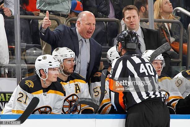 Head coach Claude Julien of the Boston Bruins argues a call on the ice with Referee Steve Kozari in the first period against the New York Rangers at...