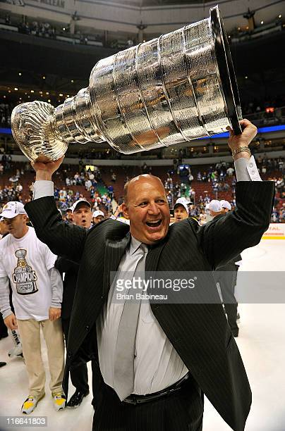 Head coach Claude Julien of the Boston Bruins celebrates as he lifts the Stanley Cup after his team defeated the Vancouver Canucks 40 in Game Seven...