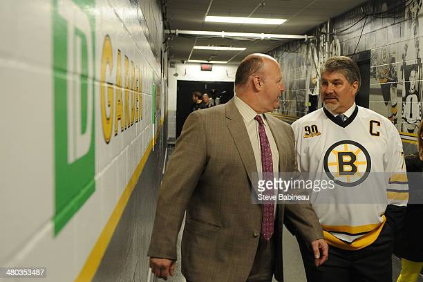 Head Coach Claude Julien of the Boston Bruins chats with former player and legend Ray Bourque before the puck drop against the Montreal Canadiens at...