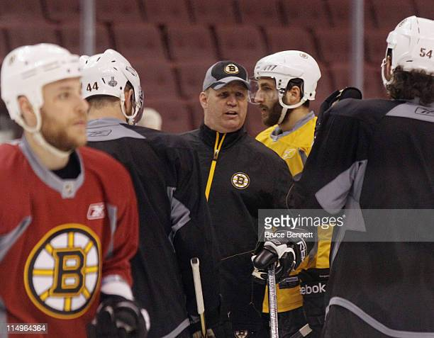 Head coach Claude Julien of the Boston Bruins conducts a practice session the day before the opening game of the 2011 NHL Stanley Cup Finals at the...