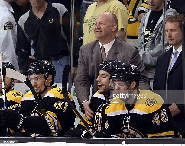Head coach Claude Julien of the Boston Bruins congratulates Milan Lucic after he scored the game winner in the third period against the Philadelphia...