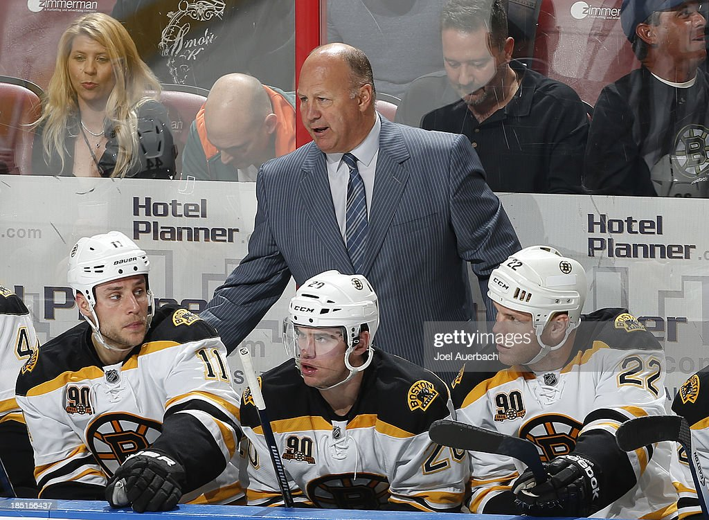 Head coach <a gi-track='captionPersonalityLinkClicked' href=/galleries/search?phrase=Claude+Julien&family=editorial&specificpeople=582124 ng-click='$event.stopPropagation()'>Claude Julien</a> of the Boston Bruins directs the players during third period action against the Florida Panthers at the BB&T Center on October 17, 2013 in Sunrise, Florida. The Bruins defeated the Panthers 3-2.