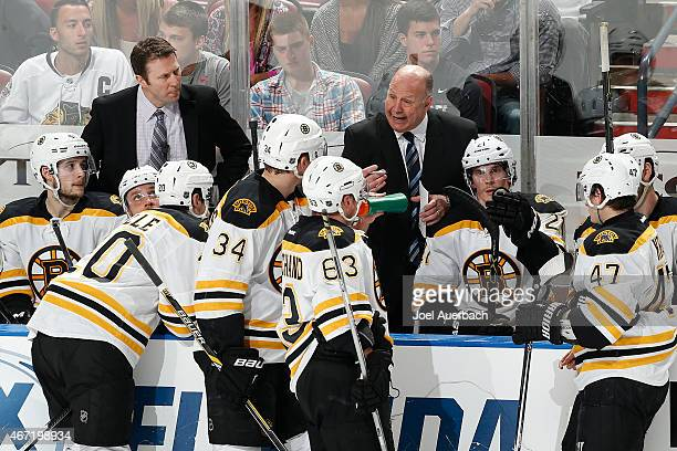 Head coach Claude Julien of the Boston Bruins directs the players prior to the start of the overtime period against the Florida Panthers at the BBT...