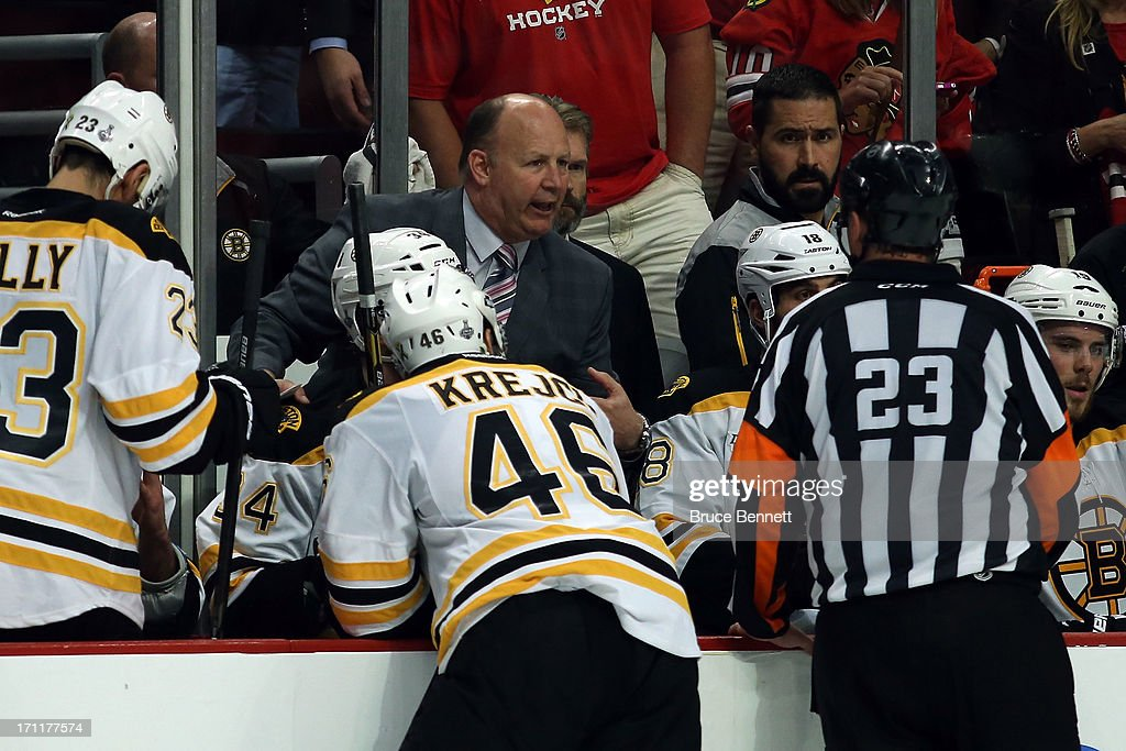 Head Coach Claude Julien of the Boston Bruins discuses matters with referee Brad Watson #23 during the game against the Chicago Blackhawks in Game Five of the 2013 NHL Stanley Cup Final at United Center on June 22, 2013 in Chicago, Illinois. The Blackhawks defeated the Bruins 3-1.