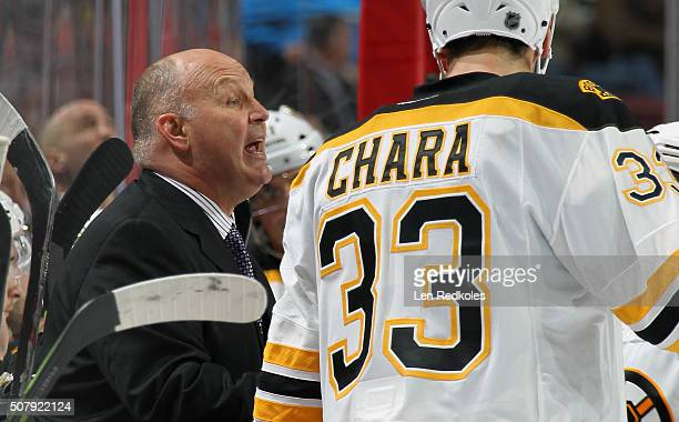 Head Coach Claude Julien of the Boston Bruins discusses strategy during a timeout against the Philadelphia Flyers on January 25 2016 at the Wells...
