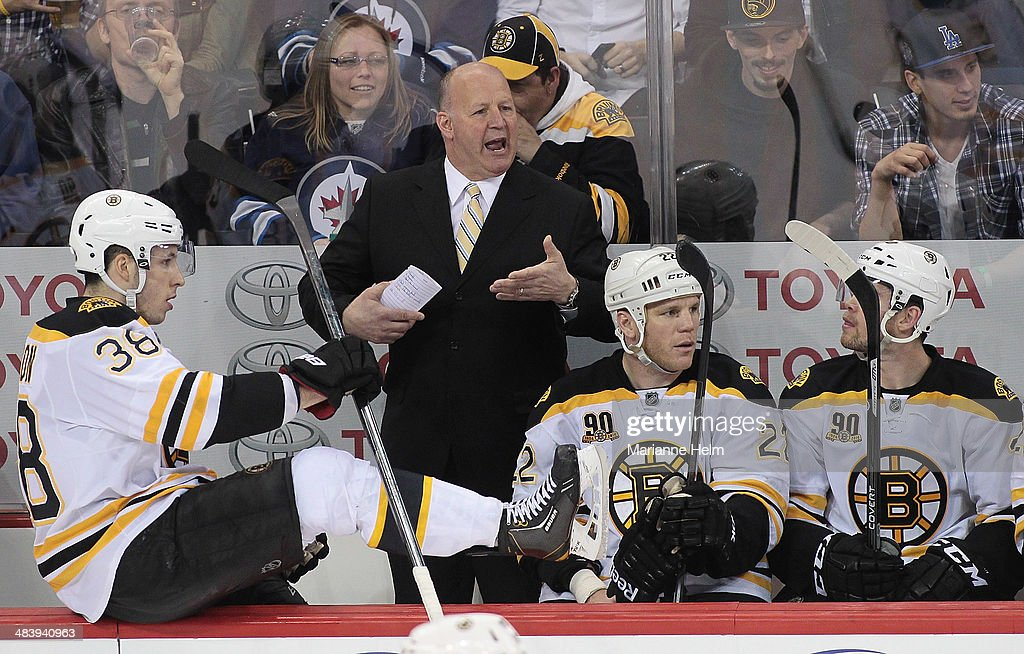 Head coach <a gi-track='captionPersonalityLinkClicked' href=/galleries/search?phrase=Claude+Julien&family=editorial&specificpeople=582124 ng-click='$event.stopPropagation()'>Claude Julien</a> of the Boston Bruins gestures from the bench in third-period action in an NHL game against the Winnipeg Jets at the MTS Centre on April 10, 2014 in Winnipeg, Manitoba, Canada.