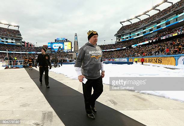 Head coach Claude Julien of the Boston Bruins leaves the field after the first period of the 2016 Bridgestone NHL Classic against the Montreal...