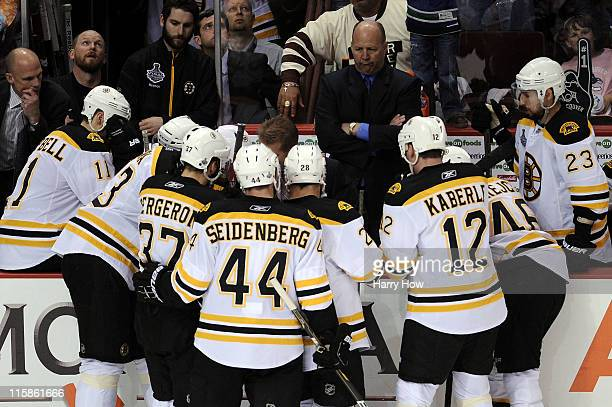 Head coach Claude Julien of the Boston Bruins looks at his team during a time out against the Vancouver Canucks during Game Five of the 2011 NHL...